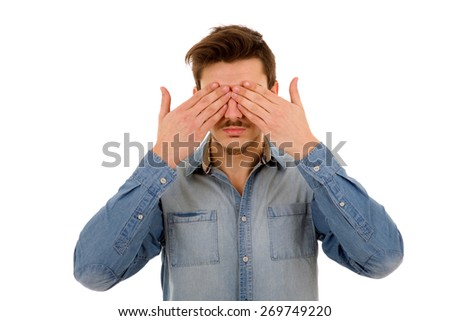 Man covering his face, isolated on white background - stock photo
