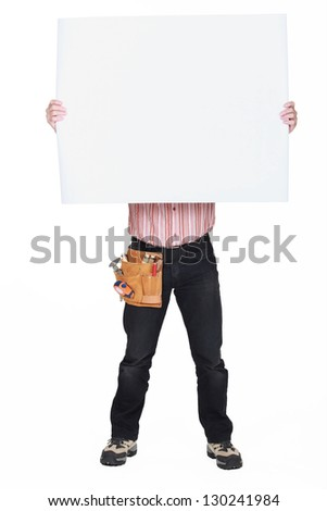 Man covering his face with a blank sign - stock photo