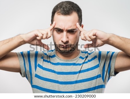 Man covering his hears
