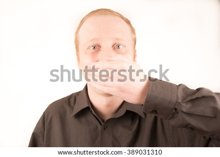 man covering mouth with hand