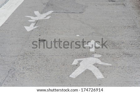 Man Crossing Road Symbol. Silhouette of a person walking painted - stock photo