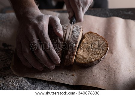 man cuts bread