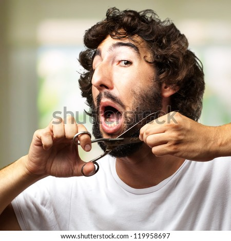 Man Cutting Beard against an abstract background