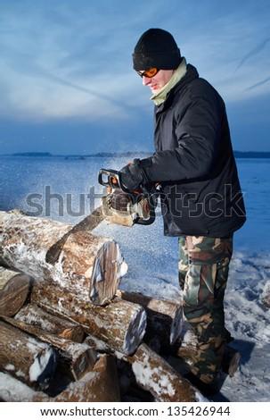 man cutting firewood - stock photo