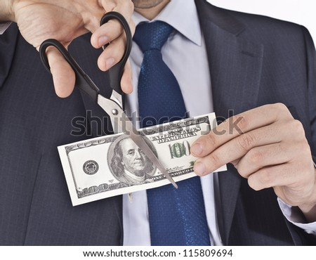 Man cutting money