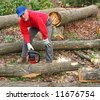 Man cutting oak log into sections - stock photo