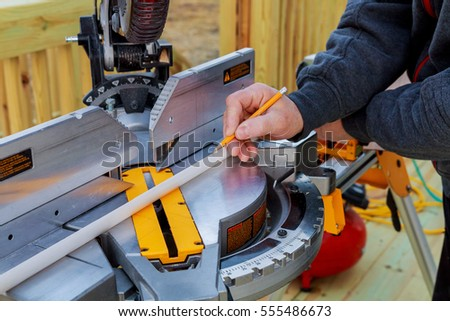man cutting wood on electric saw Saws for cutting trees