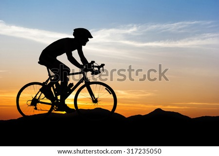 Man cycling on black mountain twilight time in Thailand