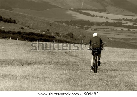 Man cycling on Sussex downs