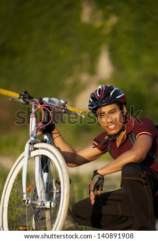 man cyclist resting . Travel and outdoor recreation. - stock photo