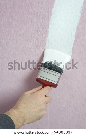 man decorating or painting with a paint brush