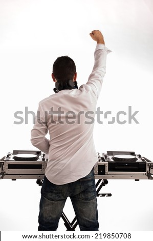 Man deejay back against the white background and raised fist - stock photo