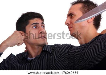 Man defending himself against a knife attack isolated on white