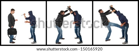 Man defending himself against a knife attack using a briefcase. Self-defense concept - stock photo