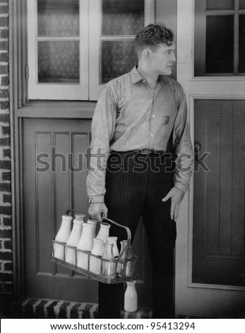 Man delivering milk - stock photo