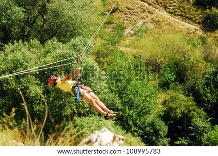 man descending on a zip-line (flying fox)
