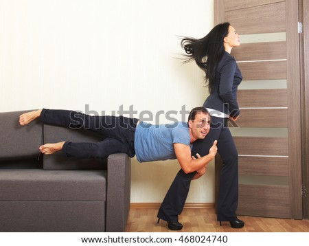 Man desperately clinging to the leg of a woman
