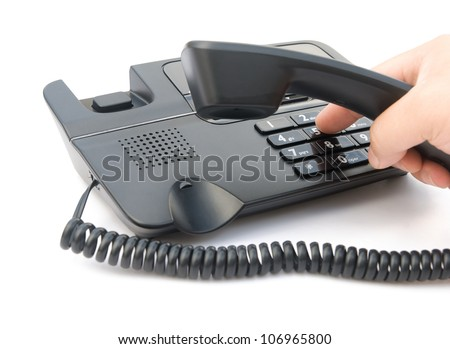 man dialing a black telephone with clipping path - stock photo