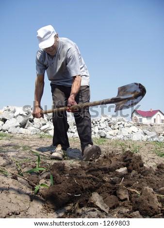 man digs kitchen garden - stock photo