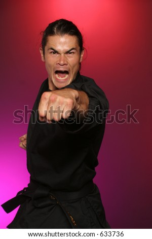 man displays anger when provoked into a fight - stock photo