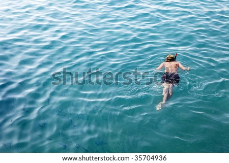 man diving in sea in summer day