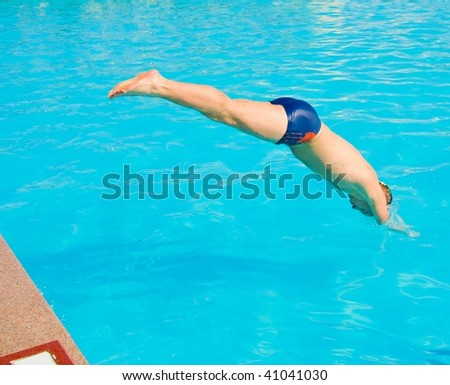 Man diving into pool in Egypt - stock photo