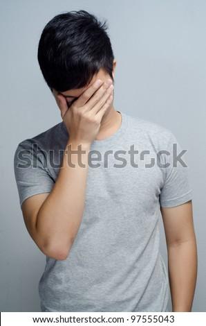Man do a facepalm - stock photo