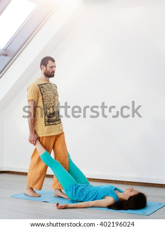 Man does thai massage for women - stock photo