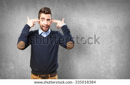 man doing a suicide gesture