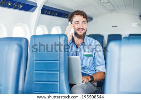 Man doing business in the airplane - stock photo