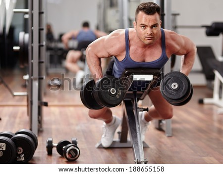 Man doing dumbbell row workout for back muscles