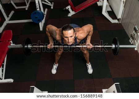 Man Doing Exercise For Back With Barbell - stock photo