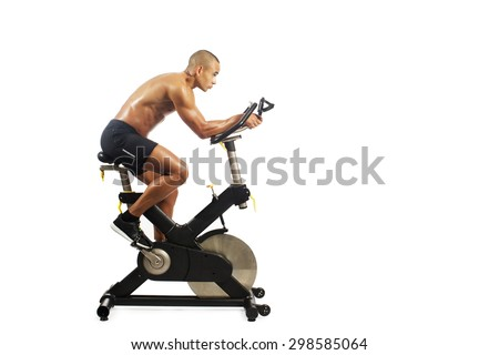 man doing exercise on bike on white background  - stock photo