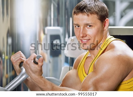 man doing exercises on a body-builder