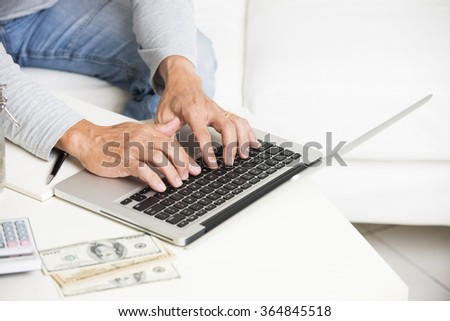 Man doing finance with tablet computer and mobile phone - stock photo