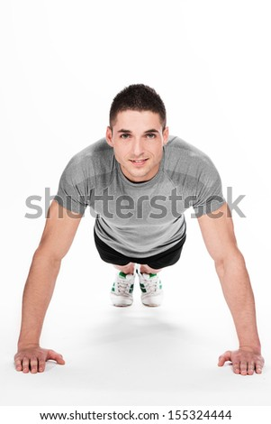 Man doing fitness exercise - stock photo