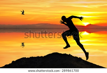 Man doing gymnastics on the lake - stock photo