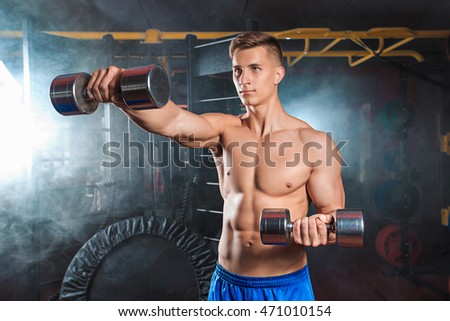 Man doing heavy weight exercise with dumbbells in gym
