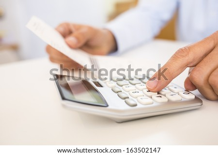 Man doing his accounting, financial adviser working
