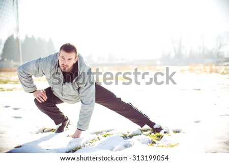 Man doing his training on winter day - stock photo
