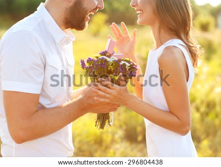 man doing on the nature engagement girl, surprise, emotion, sunset - stock photo