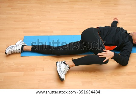 Man doing postural exercises in the gym. - stock photo