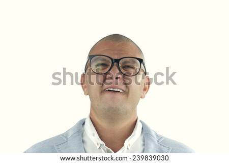 man doing silly face with nerd glasses isolated on white - stock photo