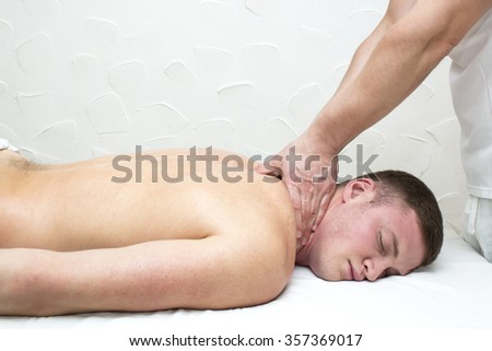 man doing sports massage at the massage parlor