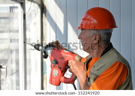 Man doing the construction work with the punch