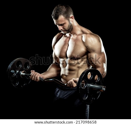 Man doing weight lifting in gym on black background. - stock photo
