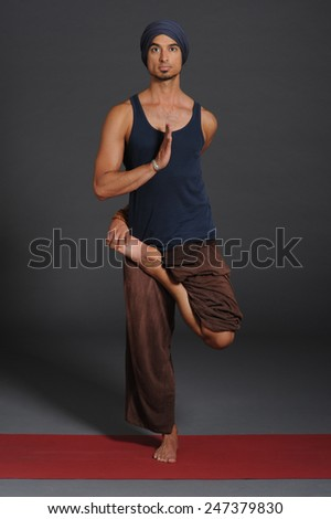Man doing yoga - stock photo