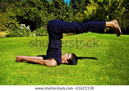 Man doing yoga in nature. - stock photo