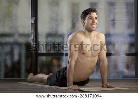 man doing yoga in office
