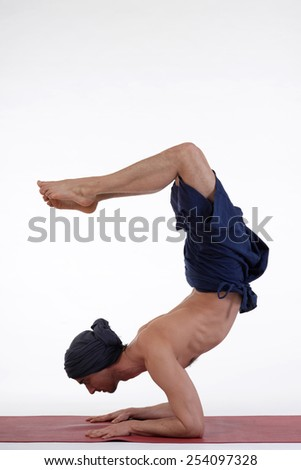 Man doing yoga on isolated white background. - stock photo